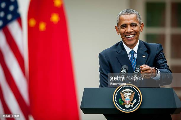 US President Barack Obama smiles during a joint news conference with Xi Jinping China's president not pictured in the Rose Garden at the White House...