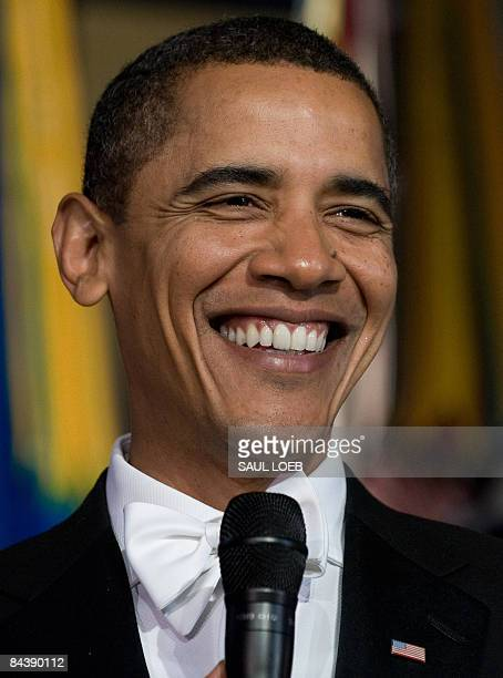 President Barack Obama smiles during the Youth Inaugural Ball at the Hilton Washington in Washington, DC, January 20, 2009. Obama was sworn in as the...