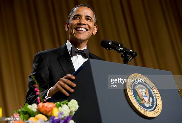 US President Barack Obama smiles while delivering remarks at the 2012 White House Correspondents' Association Dinner held at the Washington Hilton on...