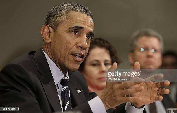 S President Barack Obama speaks about federal education funding during a meeting in the Roosevelt Room of the White House with a group of...