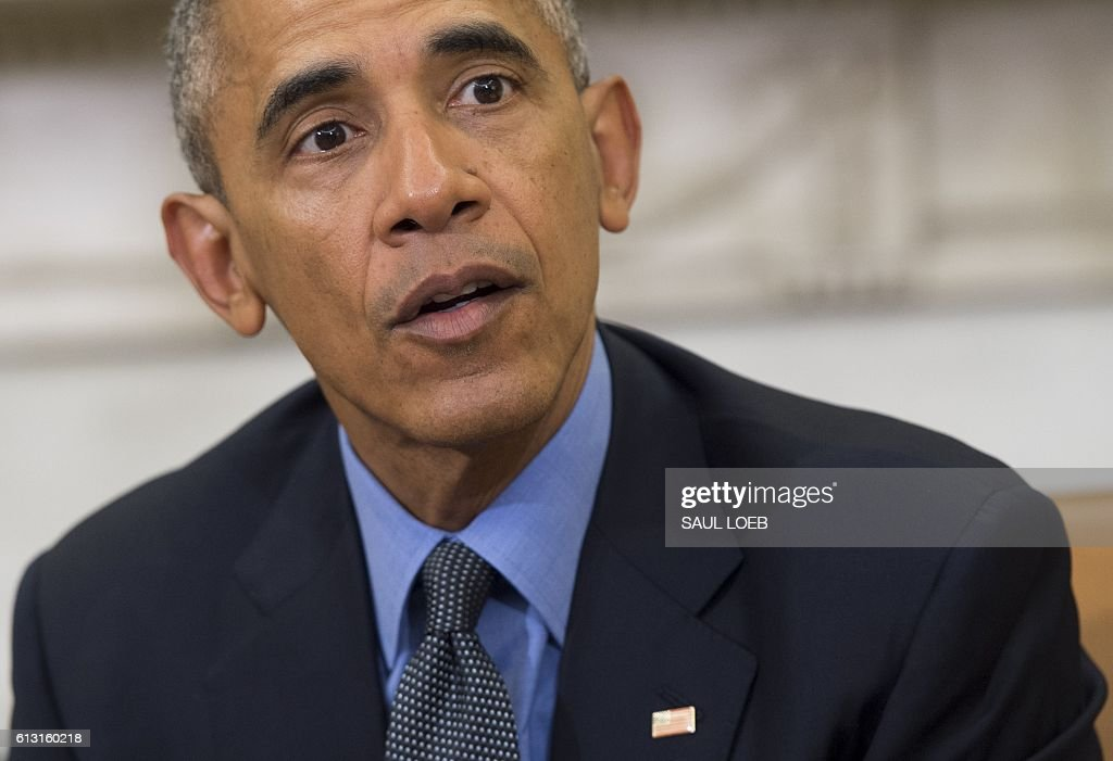 US President Barack Obama speaks about Hurricane Matthew following the Presidential Daily Briefing in the Oval Office of the White House in Washington, DC, October 7, 2016. Hurricane Matthew was downgraded to a Category Three storm Friday as it churned just off Florida and threatened to pummel the US southeast after wreaking havoc in the Caribbean. / AFP / SAUL