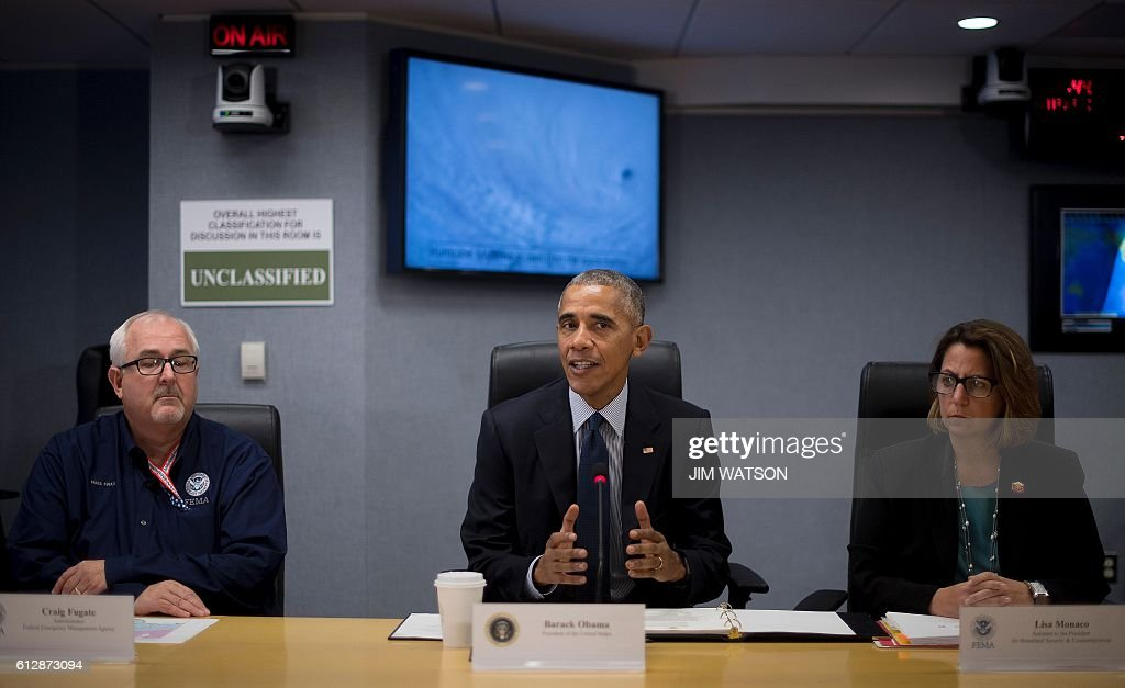US President Barack Obama speaks about Hurricane Matthew with FEMA Administrator Craig Fugate (L) and Assistant to the President for Homeland Security and Counterterrorism Lisa Monaco (R) after receiving a briefing at the Federal Emergency Management Agency (FEMA) Headquarters in Washington, DC, October 5, 2016. / AFP / JIM