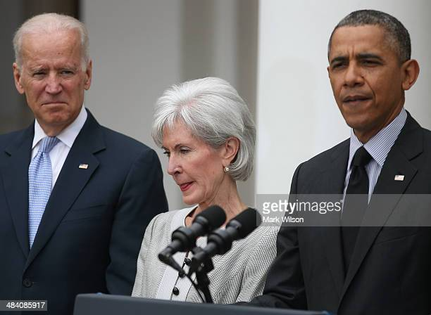 S President Barack Obama speaks about outgoing Health and Human Services Secretary Kathleen Sebelius while US Vice President Joe Biden listens during...