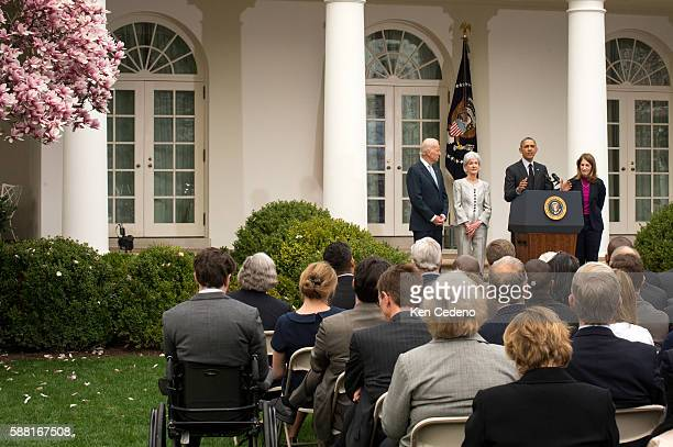 US President Barack Obama speaks about outgoing Health and Human Services Secretary Kathleen Sebelius while US Vice President Joe Biden and Director...