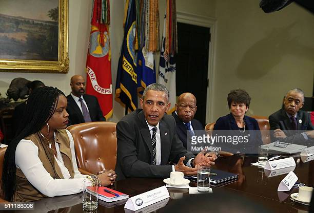 S President Barack Obama speaks about race relations while flanked by Brittany Packnett Rep John Lewis Senior Advisor Valerie Jarrett and Rev Al...