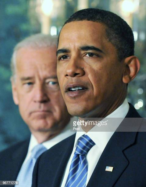 President Barack Obama speaks about recovery efforts in Haiti from the Diplomatic Reception Room at the White House as Vice President Joe Biden looks...