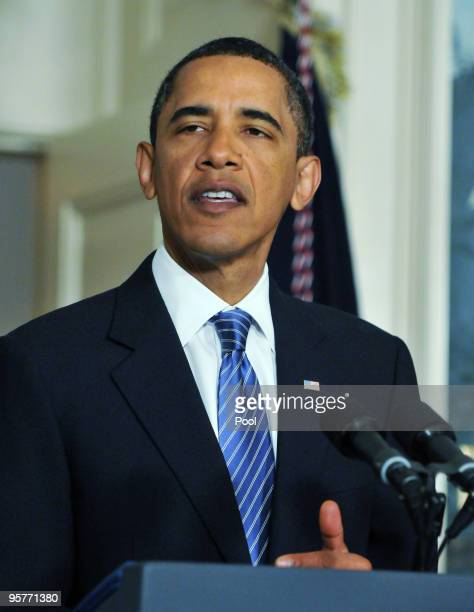 S President Barack Obama speaks about recovery efforts in Haiti from the Diplomatic Reception Room at the White House as Vice President Joe Biden...