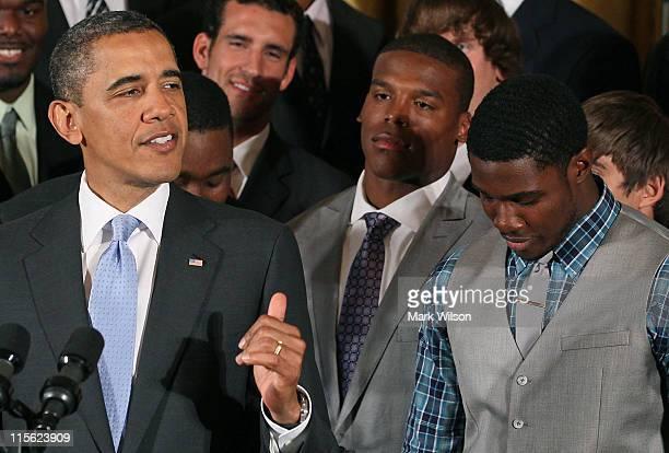 President Barack Obama speaks about the 2011 BCS National Champion Auburn University football team as Cameron Cam Newton and wide receiver Kodi Burns...