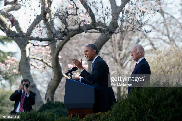 S President Barack Obama speaks about the Affordable Care Act as US Vice President Joe Biden watches in the Rose Garden of the White House on April 1...