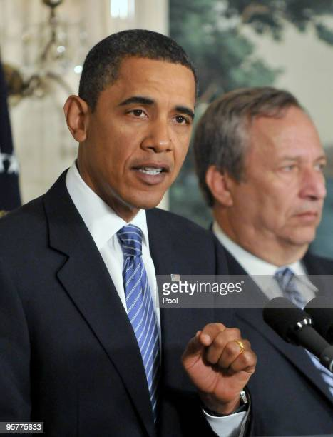 S President Barack Obama speaks about the financial crisis responsibility fee in the Diplomatic Reception Room at the White House as Lawrence Summers...