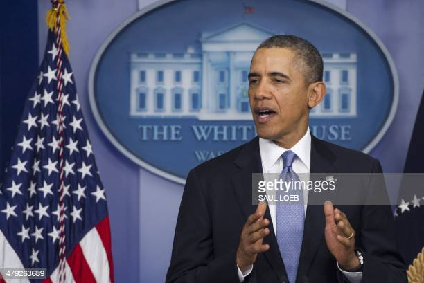 US President Barack Obama speaks about the situation in the Crimea region of Ukraine during a statement in the Brady Press Briefing Room of the White...