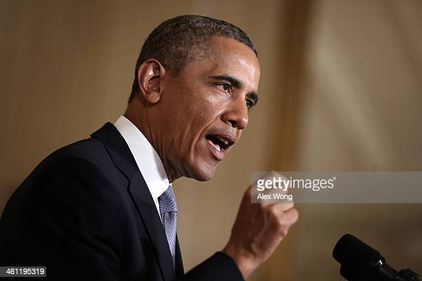 S President Barack Obama speaks about unemployment insurance benefits during an East Room event January 7 2014 at the White House in Washington DC...