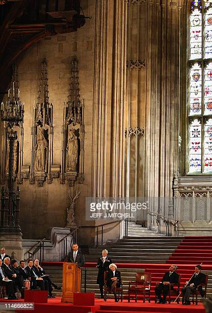 US President Barack Obama speaks accompanied by the Lords Speaker Baroness Helen Hayman Lieutenant General David Leakey known as 'Black Rod' Lord...