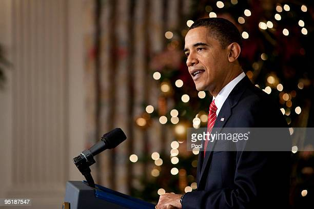 President Barack Obama speaks after the Senate passed their version of health care reform legislation in the State Dining Room at the White House...