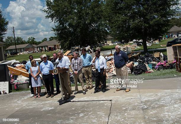 President Barack Obama speaks after touring a flood-affected area in Baton Rouge, Louisiana, on August 23, 2016. / AFP / NICHOLAS KAMM