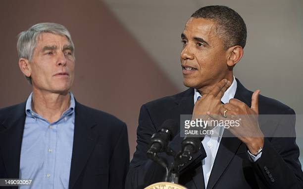 President Barack Obama speaks alongside Colorado Senator Mark Udall as he retells a story he heard from one of the victims about holding her fingers...