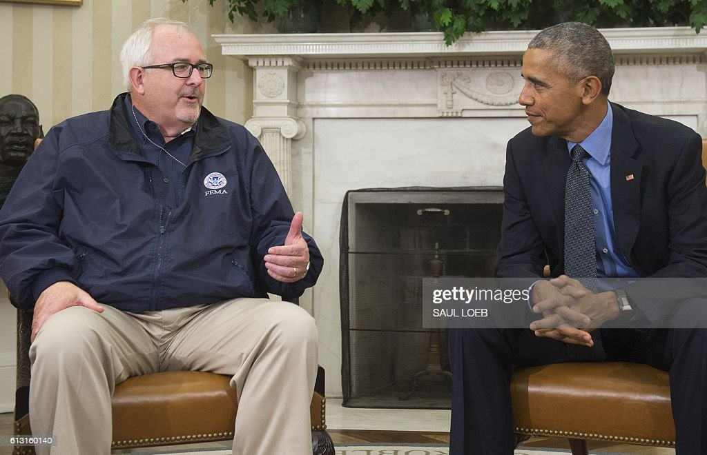 US President Barack Obama speaks alongside FEMA Administrator Craig Fugate about Hurricane Matthew following the Presidential Daily Briefing in the Oval Office of the White House in Washington, DC, October 7, 2016. Hurricane Matthew was downgraded to a Category Three storm Friday as it churned just off Florida and threatened to pummel the US southeast after wreaking havoc in the Caribbean. / AFP / SAUL