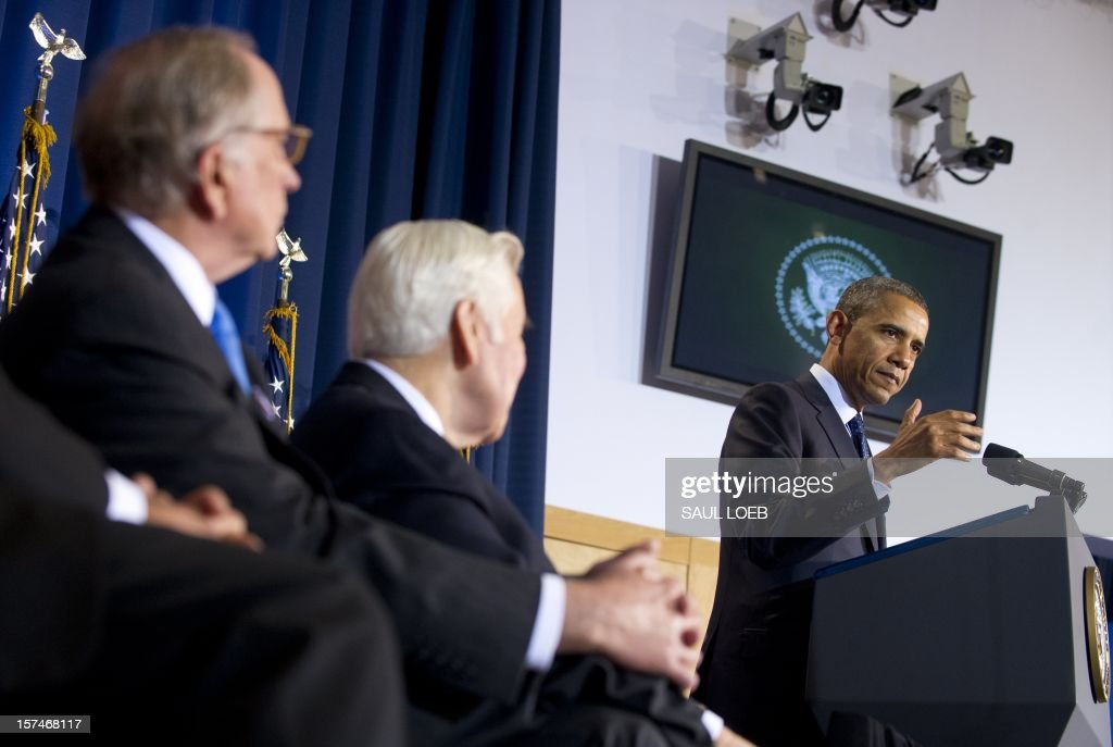 US President Barack Obama speaks alongside Indiana Republican Senator Richard Lugar (C) and former Georgia Democratic Senator Sam Nunn (L) during the Nunn-Lugar Cooperative Threat Reduction (CTR) symposium at the National Defense University in Washington on December 3, 2012. Obama directly warned Syria's President Bashar al-Assad that he would face 'consequences' if he made the 'tragic mistake' of turning chemical weapons on his own people. AFP PHOTO / Saul LOEB
