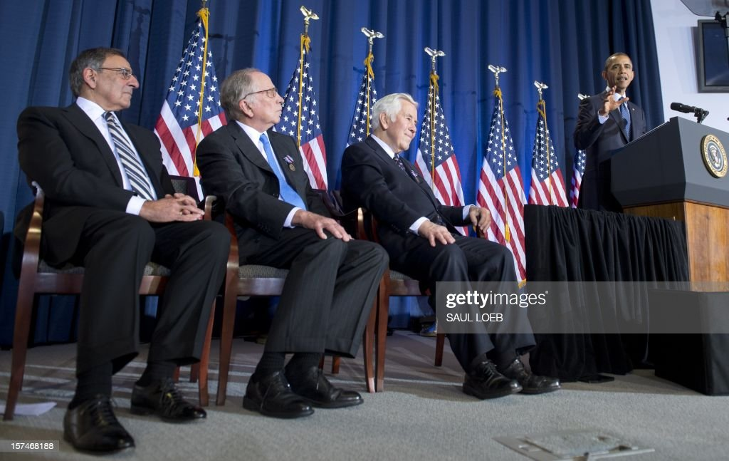 US President Barack Obama speaks alongside Indiana Republican Senator Richard Lugar (2nd R), former Georgia Democratic Senator Sam Nunn (2nd L) and US Secretary of Defense Leon Panetta (L) during the Nunn-Lugar Cooperative Threat Reduction (CTR) symposium at the National Defense University in Washington on December 3, 2012. Obama directly warned Syria's President Bashar al-Assad that he would face 'consequences' if he made the 'tragic mistake' of turning chemical weapons on his own people. AFP PHOTO / Saul LOEB