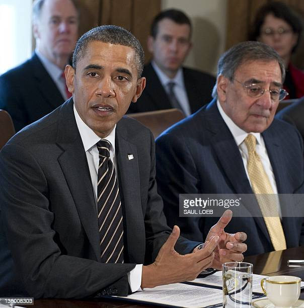 US President Barack Obama speaks alongside Secretary of Defense Leon Panetta during a Cabinet meeting in the Cabinet Room of the White House in...