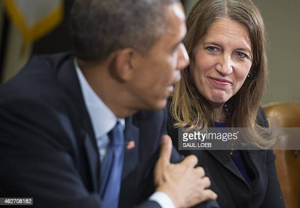 US President Barack Obama speaks alongside Secretary of Health and Human Services Sylvia Mathews Burwell during a meeting with Americans who say they...