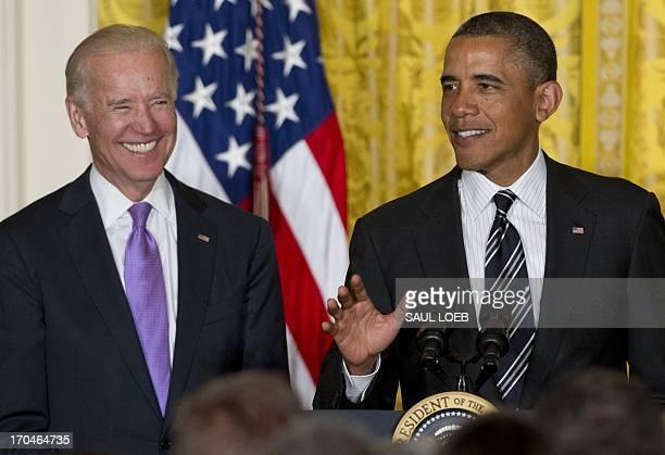 US President Barack Obama speaks alongside US Vice President Joe Biden attend a LGBT Pride Month celebration in the East Room of the White House in...
