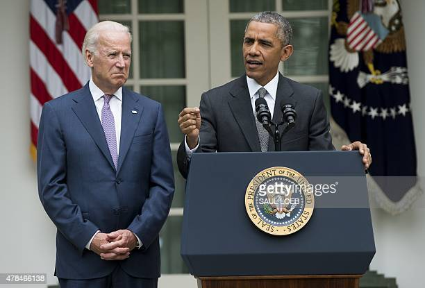 US President Barack Obama speaks alongside US Vice President Joe Biden about the Supreme Court's ruling to uphold the subsidies that comprise the...