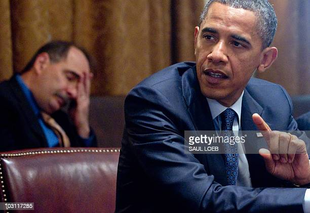 US President Barack Obama speaks alongside White House Senior Advisor David Axelrod during a meeting with Congressional leadership in the Cabinet...