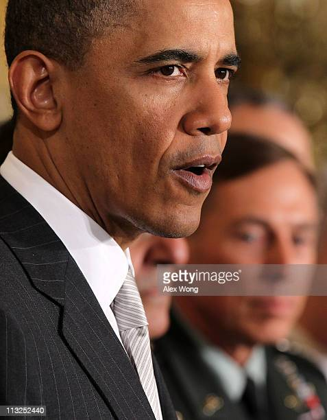 S President Barack Obama speaks as Army General David Petraeus listens during an event to announce national security personnel changes at the East...