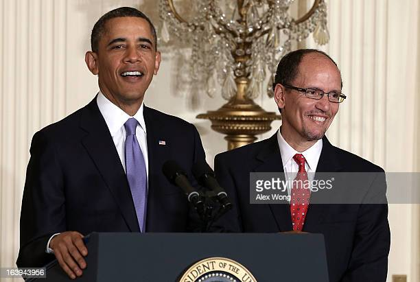 S President Barack Obama speaks as Assistant Attorney General of Justice Department's civil rights division Thomas Perez listens during a personnel...