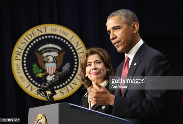 President Barack Obama speaks as banker Maria Contreras-Sweet listens during a personnel announcement January 15, 2014 at the South Court Auditorium...