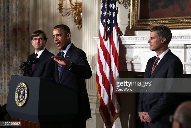 S President Barack Obama speaks as chairman of the Council of Economic Advisers Alan Krueger and economist Jason Furman listen during a personnel...