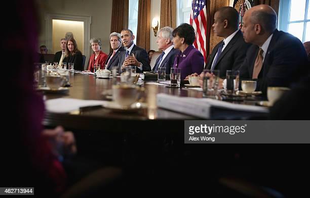 S President Barack Obama speaks as Education Secretary Arne Duncan Health and Human Services Secretary Sylvia Burwell Interior Secretary Sally Jewell...