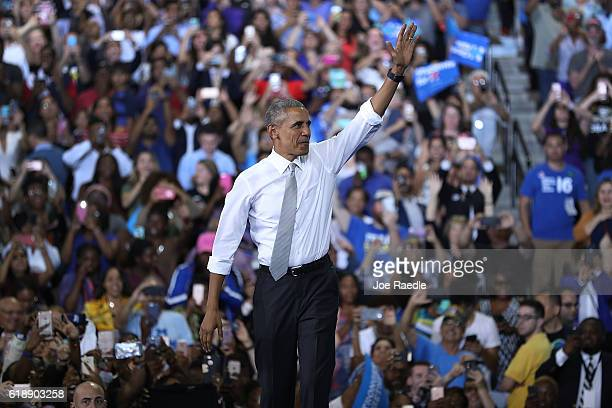 President Barack Obama speaks as he attends a campaign rally in support of Democratic presidential candidate Hillary Clinton at the University of...