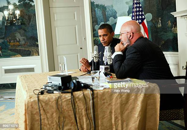 S President Barack Obama speaks as he is interviewed by radio show host Michael Smerconish during a live broadcast from the Diplomatic Reception Room...