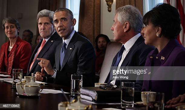 S President Barack Obama speaks as Interior Secretary Sally Jewell State Secretary John Kerry Defense Secretary Chuck Hagel and Commerce Secretary...