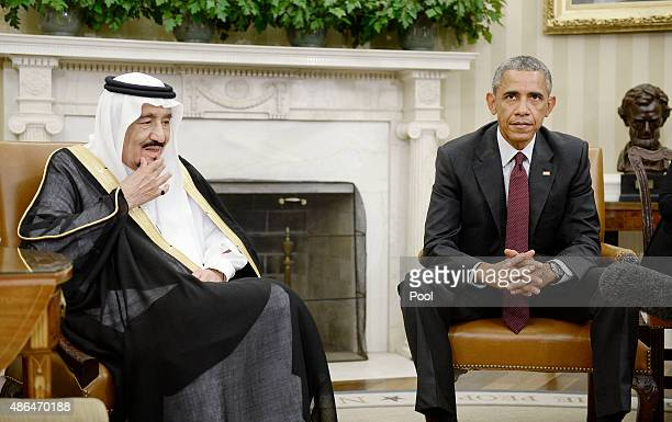 S President Barack Obama speaks as King Salman bin Abd alAziz of Saudi Arabia looks on during a bilateral meeting in the Oval Office of the White...
