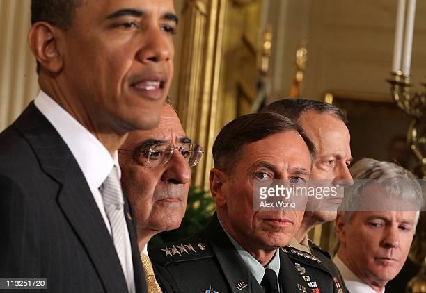 US President Barack Obama speaks as Leon Panetta Army General David Petraeus Marine General John Allen and Ambassador Ryan Crocker listen during an...