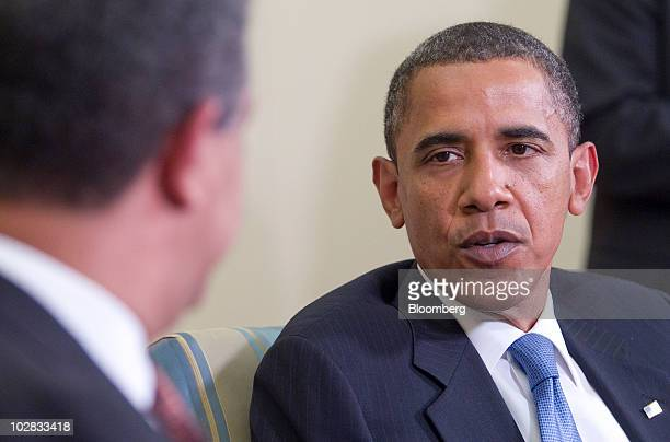 US President Barack Obama speaks as Leonel Fernandez president of the Dominican Republic listens after a bilateral meeting in the Oval Office of the...