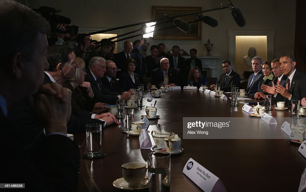 U.S. President Barack Obama (R) speaks as meets with congressional leaders in the Cabinet Room of the White House January 13, 2015 in Washington, DC. President Obama met with congressional leaders to discuss issues including the economy and the nationals security.