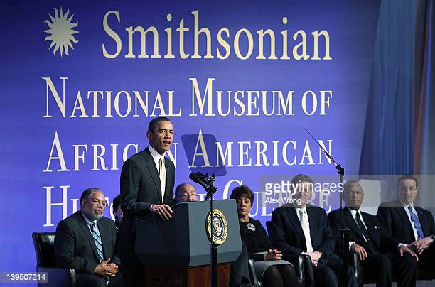 S President Barack Obama speaks as museum director Lonnie Bunch cochair of National Museum of African American History and Culture council Richard...