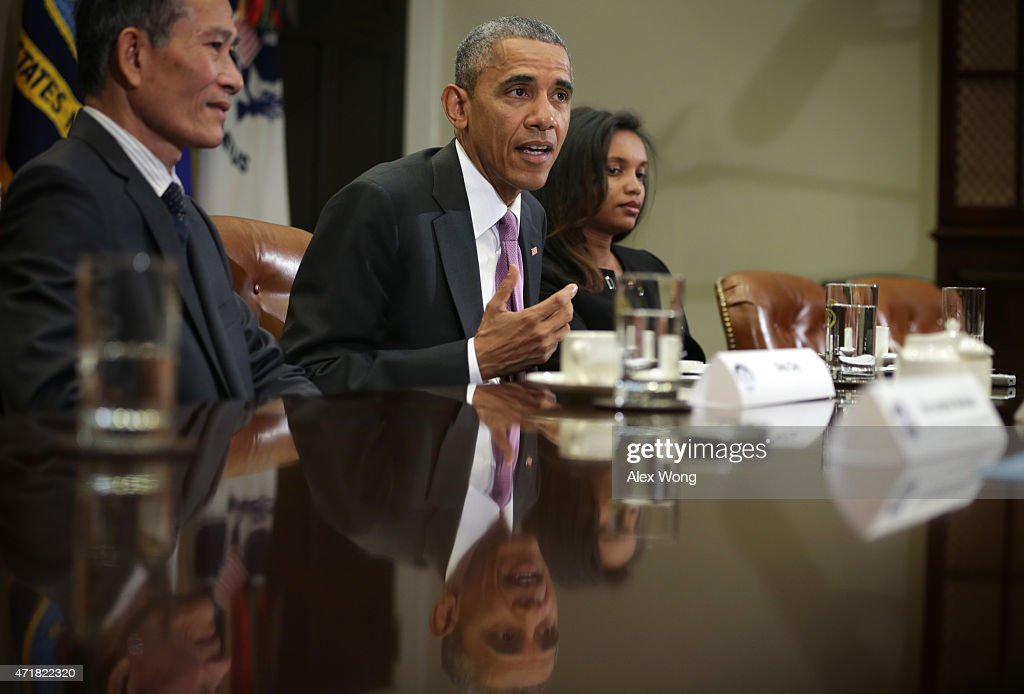 U.S. President Barack Obama (2nd L) speaks as Nguyen Van Hai (L), better known by his pen name Dieu Cay, of Vietnam, and Simegnish 'Lily' Mengesha (R) of Ethiopia listen during a roundtable with persecuted journalists at the Roosevelt Room of the White House May 1, 2015 in Washington, DC. President Obama held the meeting to mark World Press Freedom Day.