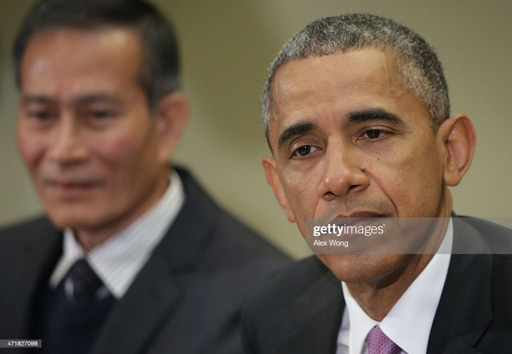 U.S. President Barack Obama (R) speaks as Nguyen Van Hai (L), better known by his pen name Dieu Cay, of Vietnam, listens during a roundtable with persecuted journalists at the Roosevelt Room of the White House May 1, 2015 in Washington, DC. President Obama held the meeting to mark World Press Freedom Day.