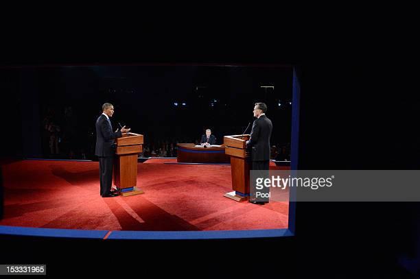 S President Barack Obama speaks as Republican presidential candidate and former Massachusetts Gov Mitt Romney listens during the Presidential Debate...