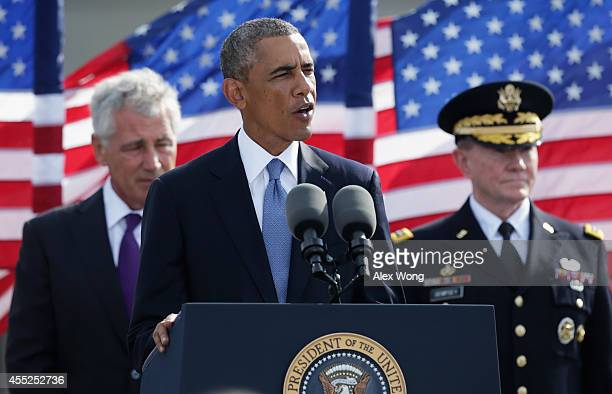 S President Barack Obama speaks as Secretary of Defense Chuck Hagel and Chairman of the Joint Chiefs Gen Martin Dempsey listen during a ceremony to...