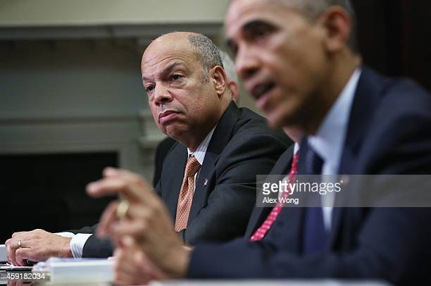 S President Barack Obama speaks as Secretary of Homeland Security Jeh Johnson listens during a meeting with his national security and public health...