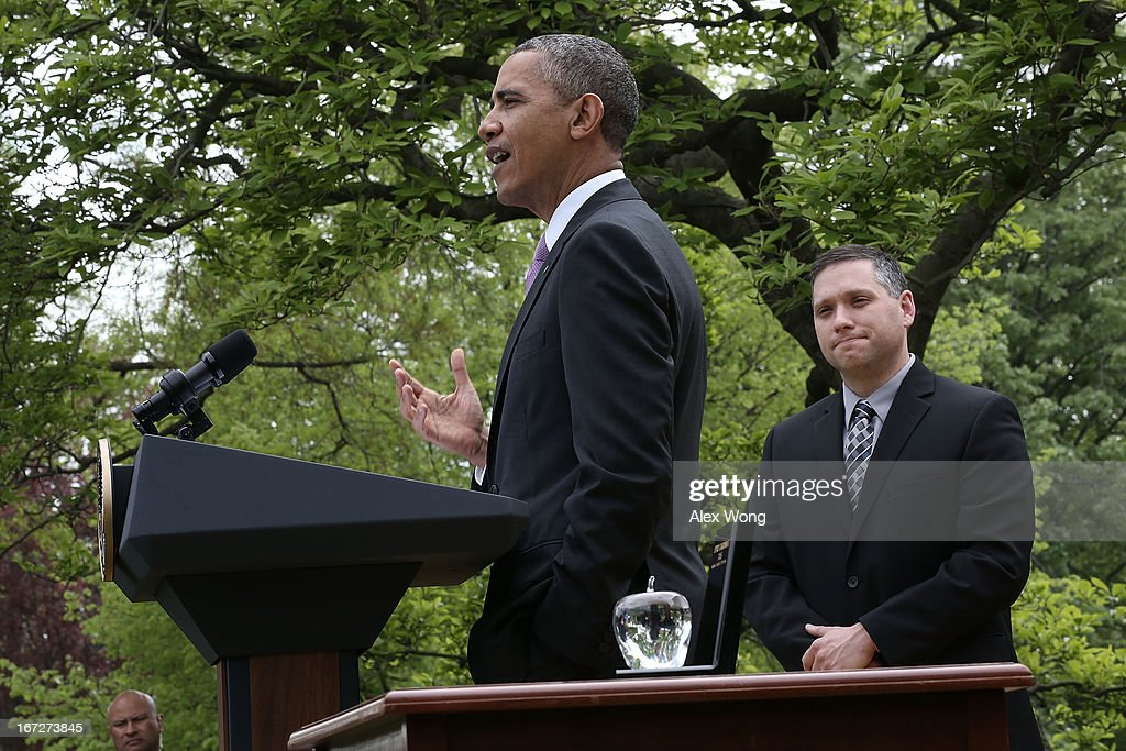 S. President Barack Obama (L) speaks as the 2013 National Teacher of the Year recipient Jeff Charbonneau, a high school science teacher from Zillah, Washington, listens during a Rose Garden event at the White House April 23, 2013 in Washington, DC. President Obama held the event to honor the 2013 National Teacher of the Year and finalists for their hard work and dedication in the classroom.
