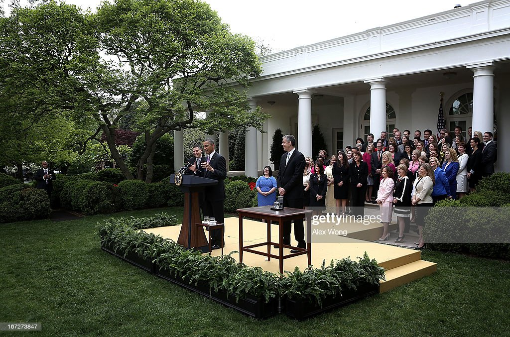 U.S. President Barack Obama (2nd L) speaks as the 2013 National Teacher of the Year recipient Jeff Charbonneau (L), a high school science teacher from Zillah, Washington, and Secretary of Education Arne Duncan (4th L) listen during a Rose Garden event at the White House April 23, 2013 in Washington, DC. President Obama held the event to honor the 2013 National Teacher of the Year and finalists for their hard work and dedication in the classroom.