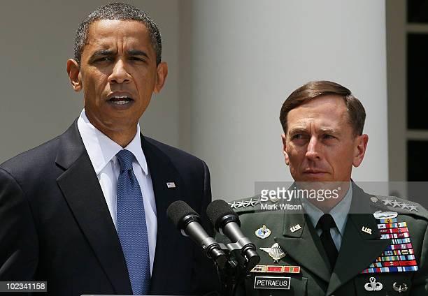 S President Barack Obama speaks as US General David Petraeus listens in the Rose Garden at the White House on June 23 2010 in Washington DC President...