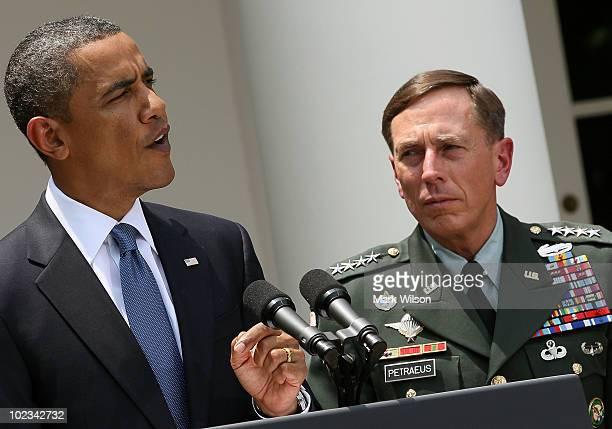 S President Barack Obama speaks as US General David Petraeus looks on in the Rose Garden at the White House on June 23 2010 in Washington DC...